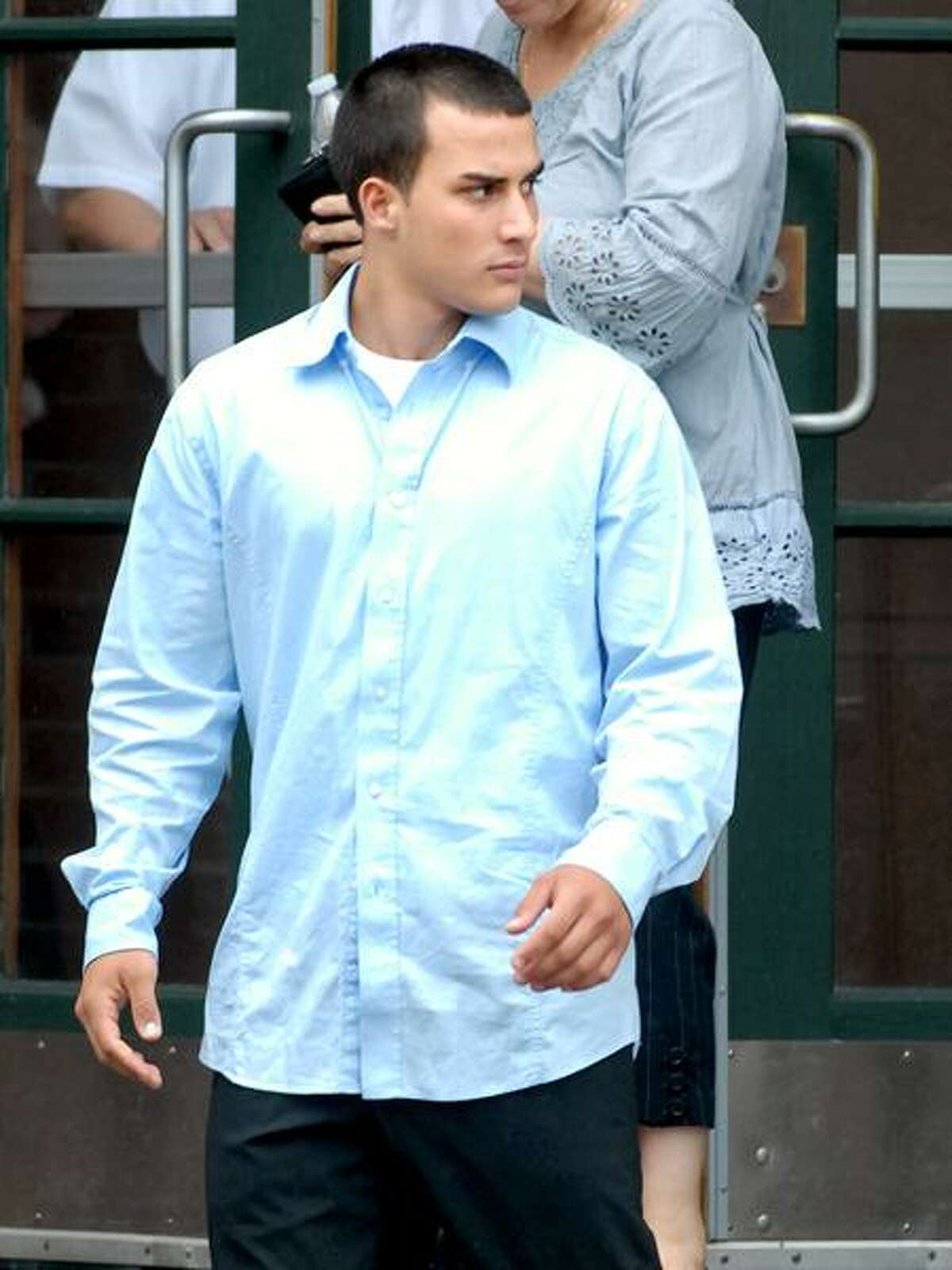 Edi Rapo leaves court after posting bail on manslaughter charges July 14, 2010. Arnold Gold/Register file photo