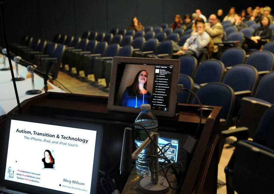 Megan Wilson, a special education teacher at the Amity Regional Middle School gives a presentation at a Southern Connecticut State University conference on adaptive technology using iPods, iPhones and iPads for students with autism. Mara Lavitt/Register  11/2/11