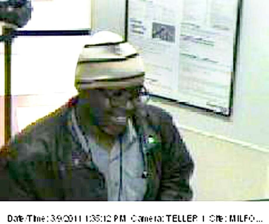 Milford police today released this photo of a man who allegedly robbed a bank on East Town Road - saying he had a gun - despite the smile on his face.