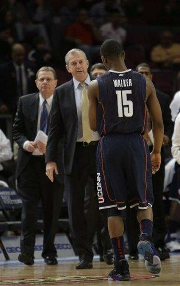 Connecticut's coach Jim Calhoun talks to Kemba Walker during a  time out in the first half of an NCAA college basketball game at the Big East Championship, Wednesday, March 9, 2011 at Madison Square Garden in New York.  (AP Photo/Mary Altaffer) Photo: AP / AP