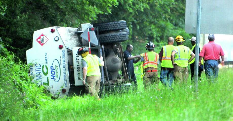Emergency personnel respond to an overturned tanker truck on southbound I-91 near exit 15 in Wallingford on 7/8/2011.Photo by Arnold Gold/New Haven Register      AG0418B