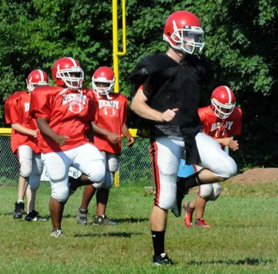 Sports_Derby Quarterback (front), Ray Krieger, at practice.   Melanie Stengel/Register