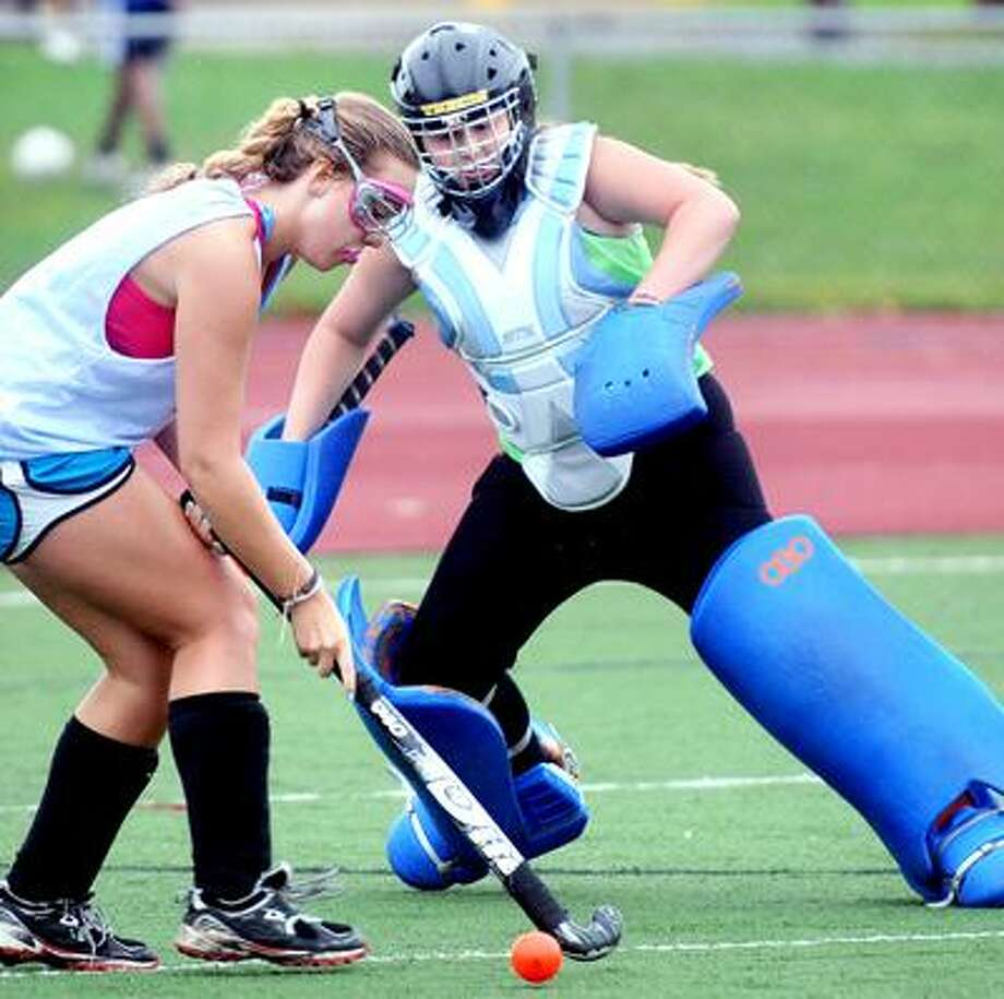 Field hockey goalie Marisa McCann (right) defends against Chandler Berke (left) during practice at Daniel Hand High School in Madison on 9/6/2011.Photo by Arnold Gold/New Haven Register    AG0423C
