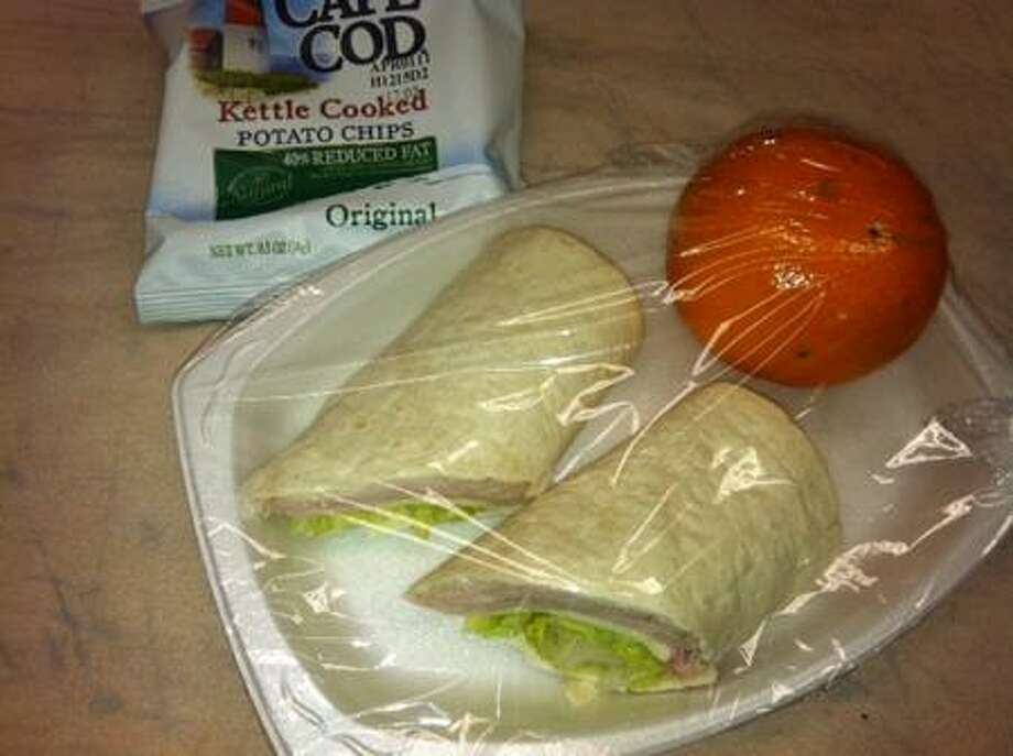 More healthful school lunch options include a turkey wrap, fruit and reduced fat potato chips.