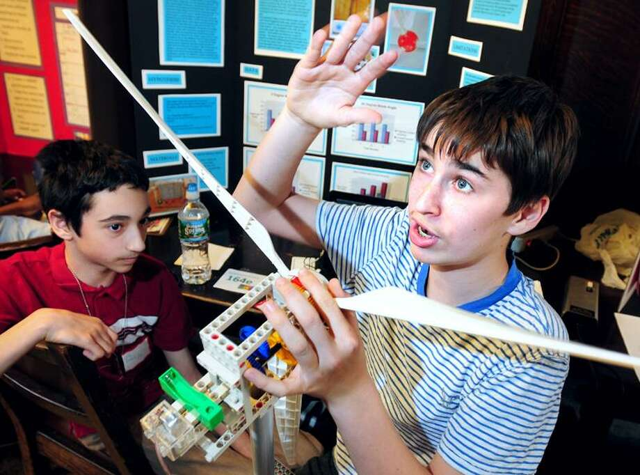 Eric Davies, left, 12, and Elan Silver, 13, of Edgewood School talk about their wind power project during the 17th annual New Haven Science Fair at Yale University Commons in New Haven Wednesday. Arnold Gold/Register