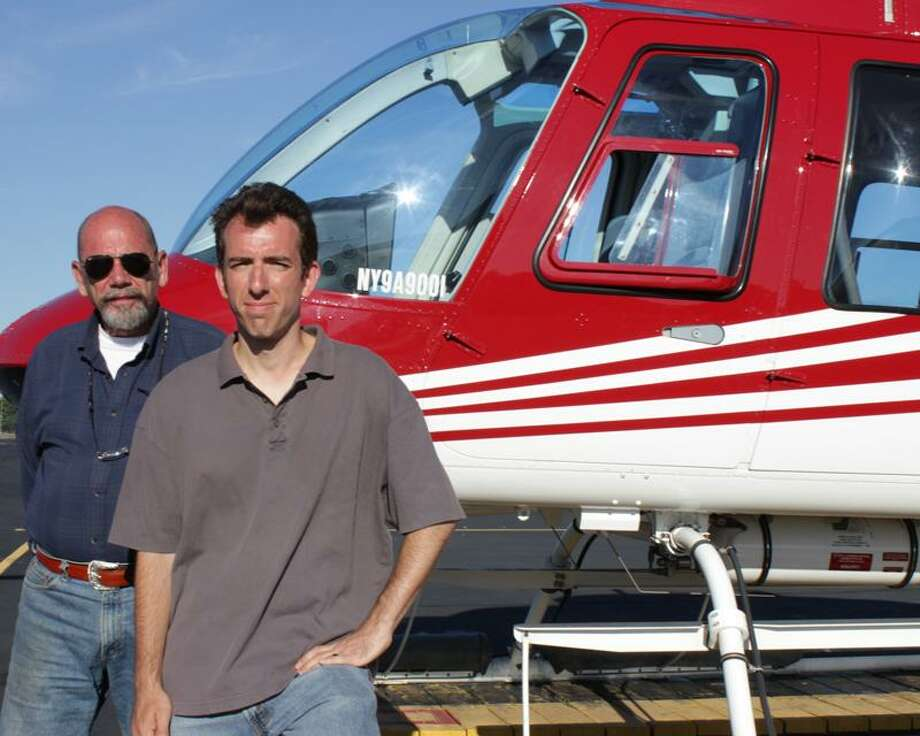 "Seven years after a fateful crash, Russ Mowry and Andrew Torres pause in front of a helicopter on ""The Indestructibles"" on NGC. / www.cinematographie.net"