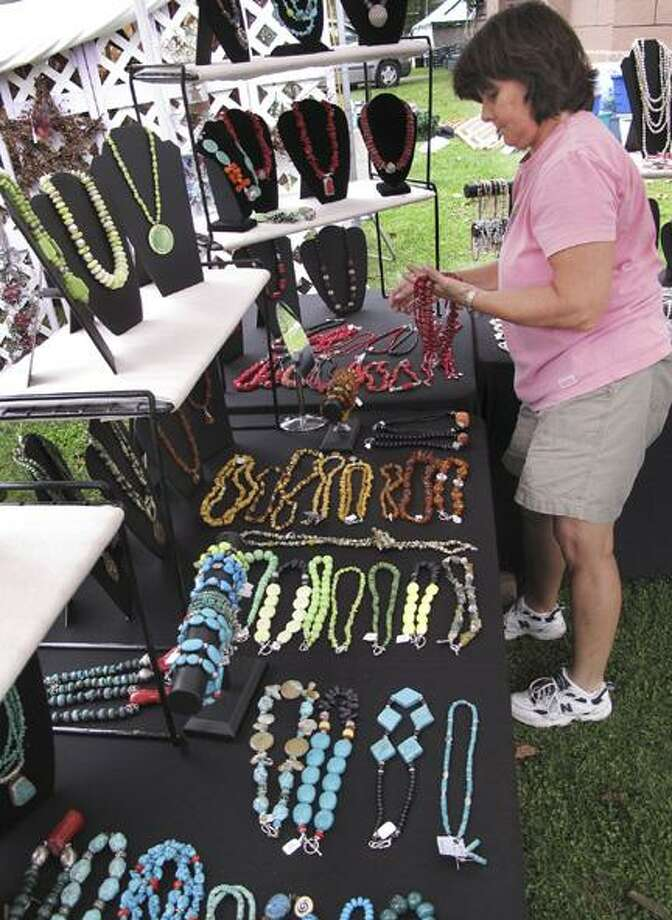 Dispatch Staff Photo by JOHN HAEGER (Twitter.com/OneidaDispatch)Nancy Powell of Kirkville sets up her jewelry booth for last year's Craft Days at the Madison County Historical Society on Friday, Sept. 10, 2010.