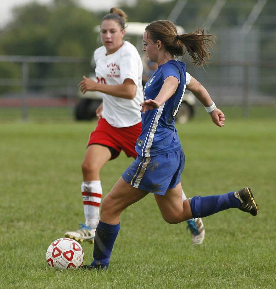 """Dispatch Staff Photo by JOHN HAEGER <a href=""""http://twitter.com/oneidaphoto"""">twitter.com/oneidaphoto</a> Camden's Lindsay Jones (15) moves the ball downfield as VVS' Micaela Shay (20) moves in to defend in the first half of their match at VVS on Thursday, Sept. 8, 2011. Shay scored both of her team's goals in a 2-1 upset win."""