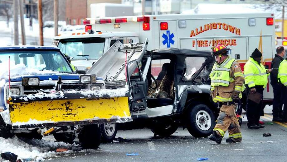 West Haven emergency personnel respond to a three vehicle accident on Rt. 1 in West Haven near the New Haven line on 1/12/2011.Photo by Arnold Gold/New Haven Register      AG0399B