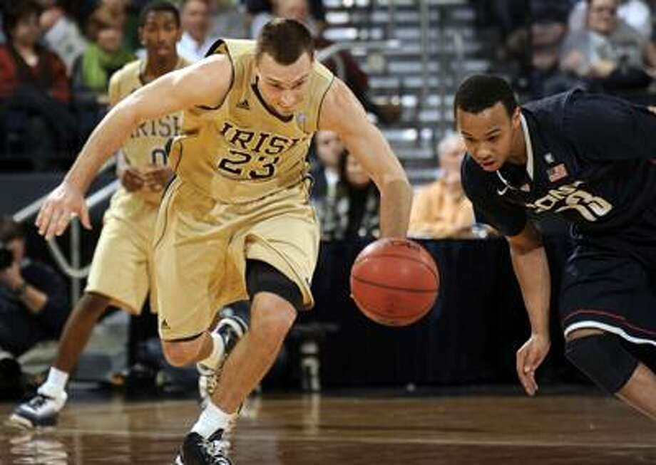 Notre Dame guard Ben Hansbrough, left, and Connecticut guard Shabazz Napier race for a loose ball during the second half of an NCAA college basketball game Tuesday, Jan. 4, 2011, in South Bend, Ind. Notre Dame won 73-70. (AP Photo/Joe Raymond) Photo: AP / Joe R. Raymond