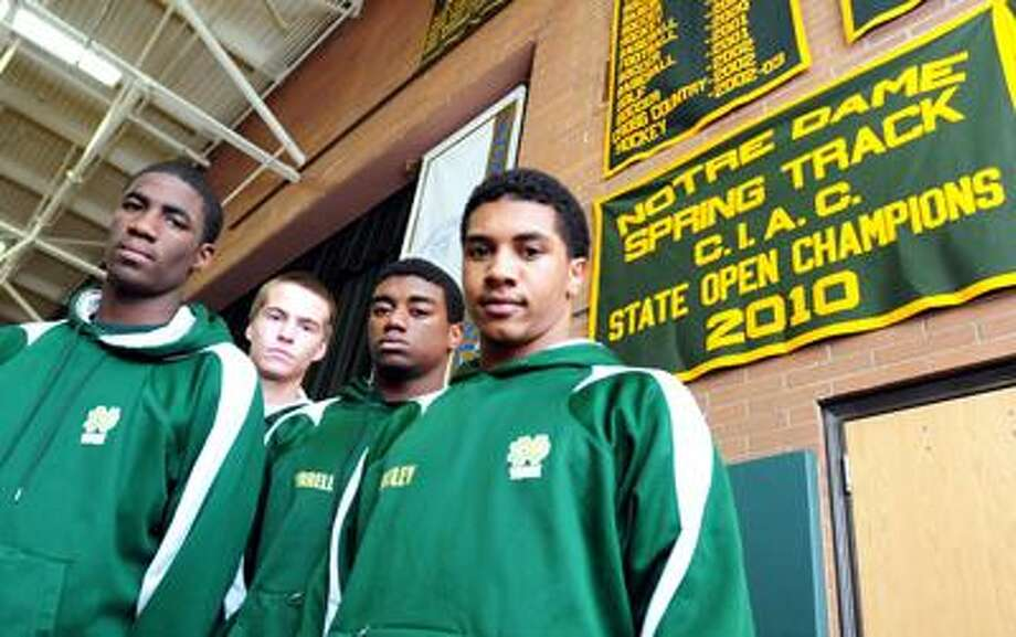 Left to right - D'Vonte Chambers, Bryan McNamara, Tirrell Young and Phil Bentley of the Notre Dame of West Haven track team are photographed in the school's gymnasium in West Haven on 1/11/2011.Photo by Arnold Gold/New Haven Register        AG0399A