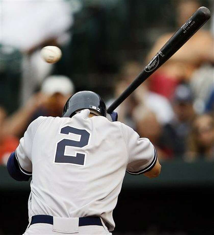 New York Yankees' Derek Jeter ducks to avoid a pitch by Baltimore Orioles pitcher Alfredo Simon in the fourth inning of a baseball game on Thursday, Sept. 8, 2011, in Baltimore. (AP Photo/Patrick Semansky) Photo: AP / AP