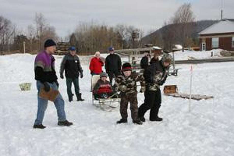Photo Courtesy TIM ETTER  Children and adults play in the snow at the 2010 DeRuyter Winter Carnival