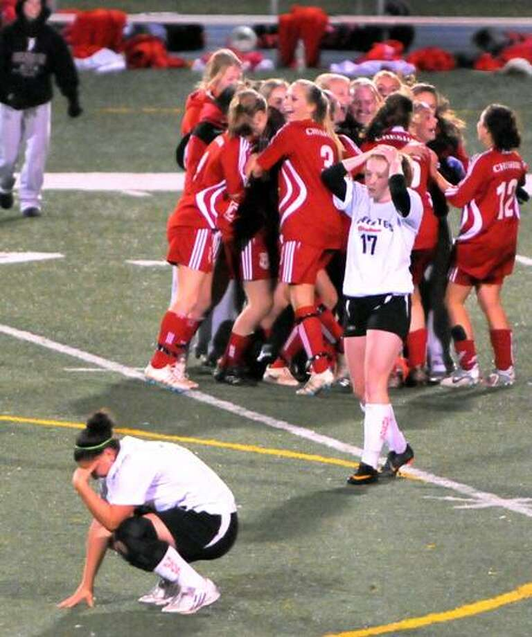 Cheshire High School celebrates its win over defending champion Shelton H.S. during the  SCC 2011 Girls Soccer Tournament Championship game Saturday 11/5/11 at East Haven High School. Saturday 11/5/11.    Photo by Peter Hvizdak / New Haven Register November 5, 2011      ph2401                 Connecticut