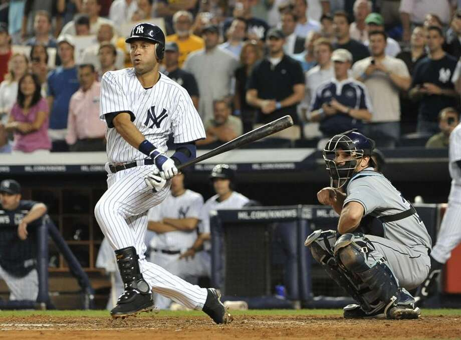 New York Yankees' Derek Jeter grounds out to third base in the fifth inning of a baseball game Thursday, July 7, 2011, at Yankee Stadium in New York. John Jaso caches for the Rays. (AP Photo/Kathy Kmonicek) Photo: AP / AP2011