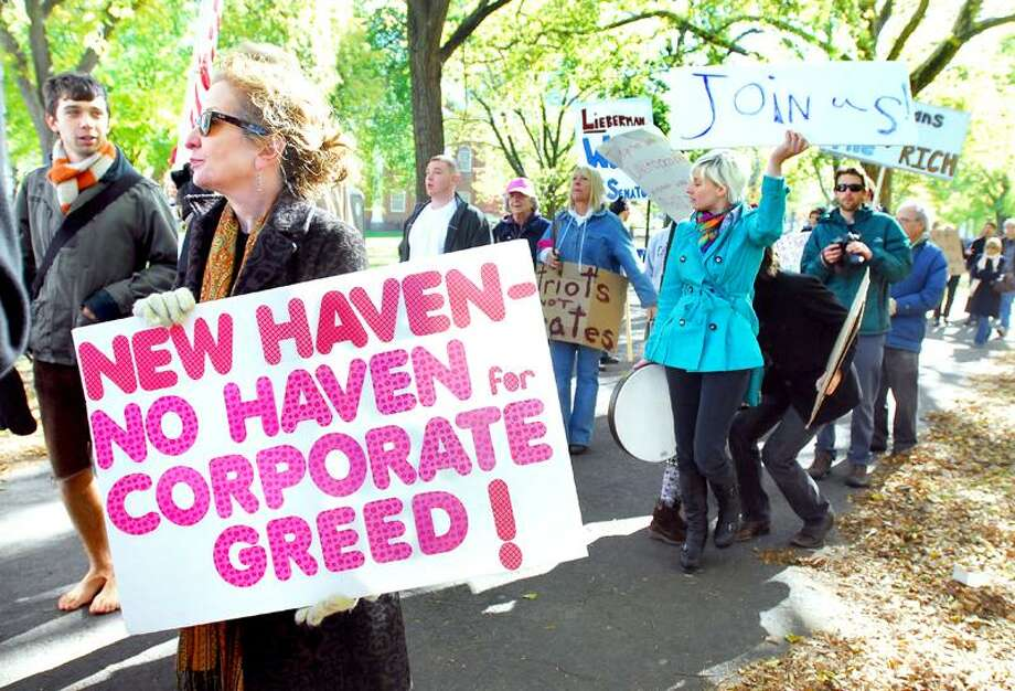 Kate DeTello Culpepper (left) of New Haven participates in an Occupy New Haven march starting on the Upper Green in New Haven on 11/5/2011.Photo by Arnold Gold/New Haven Register    AG0429D