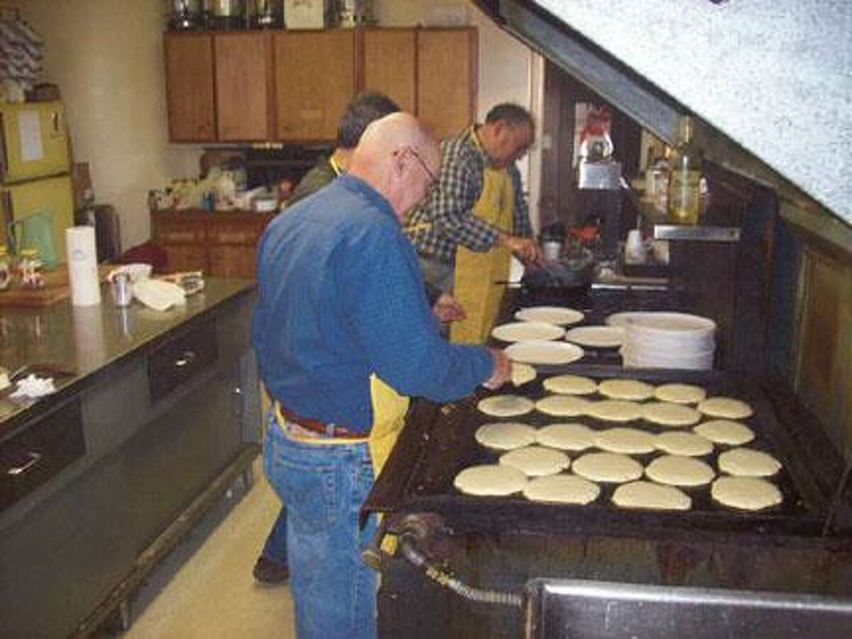 Photo Special to the Dispatch by MIKE JAQUAYS Oneida-Sherrill Lions Club members Ernie Giraud, front, Bob Visalli, center, and Tony Eppolito cook up a tasty treat during their annual Pancake Breakfast last year. The fundraiser for the sight and hearing impaired returns this Sunday to the Knights of Columbus building in Oneida.