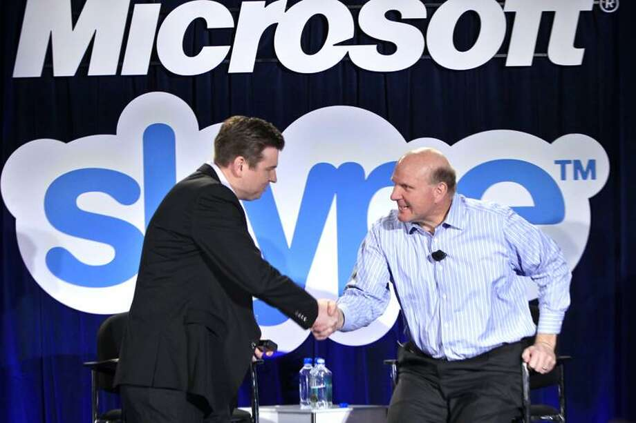 Microsoft CEO Steve Ballmer, right, and Skype CEO Tony Bates, left, shake hands during a news conference in San Francisco, Tuesday, May 10, 2011, to announce Microsoft's acquisition of Skype. (AP Photo/Paul Sakuma) Photo: AP / AP