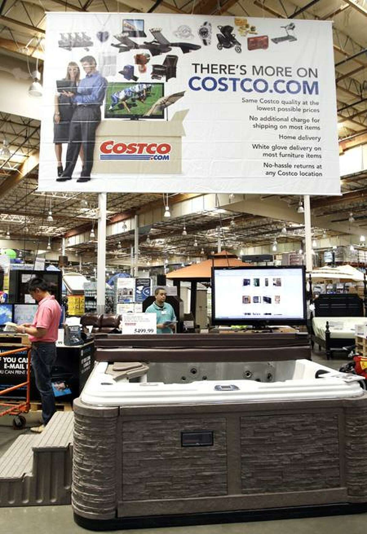 A hot tub is on display in front of an advertising for online service Costco.com at Costco in Mountain View, Calif. (Associated Press)