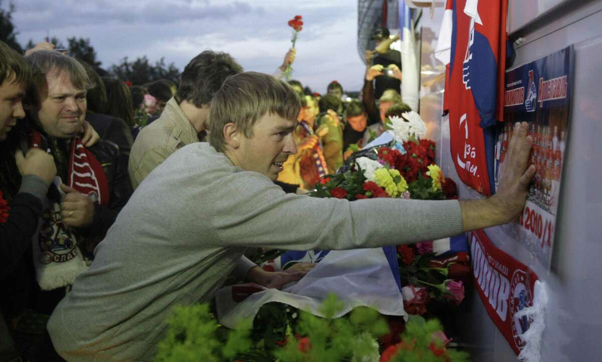 Fans of the Lokomotiv ice hockey team lay flowers and light candles at the Lokomotiv Arena to pay tribute to the Lokomotiv players killed in a plane crash, in the city of Yaroslavl, on the Volga River about 150 miles (240 kilometers) northeast of Moscow, Russia, Wednesday, Sept. 7, 2011. The Yak-42 jet carrying the Lokomotiv ice hockey team crashed while taking off Wednesday near Yaroslavl. (AP Photo/Misha Japaridze)