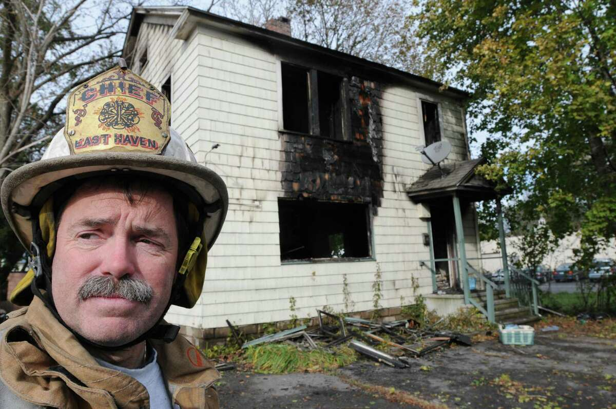 East Haven Police Chief Douglas F. Jackson at the scene of a fatal house fire at 78 Hemingway Ave. Friday 11/4/11 where one person, believed to be an adult male, died in an early-morning house fire in an apparently illegal two-family house.At least one other tenant got out safely. Photo by Peter Hvizdak / New Haven Register