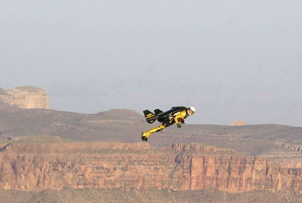 In this photo provided by Breitling, Swiss adventurer Yves Rossy, 51, is seen during his flight over the Grand Canyon in Arizona on Saturday, in his custom-built jet suit. Rossy was airborne for more than eight minutes, soaring 200 feet above the canyon rim. Associated Press