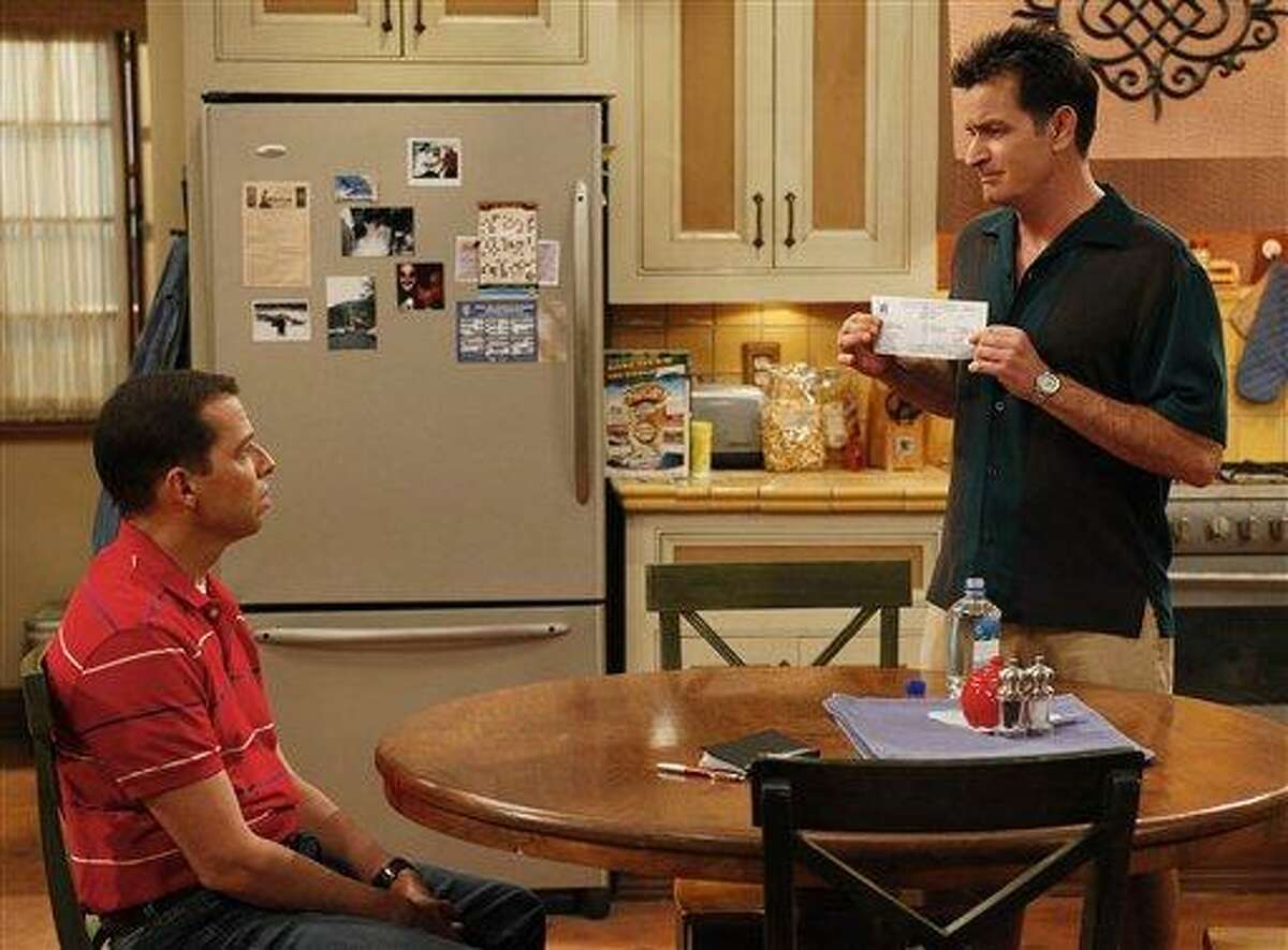 In this undated publicity image released by CBS, Jon Cryer, left, and Charlie Sheen are shown in a scene from
