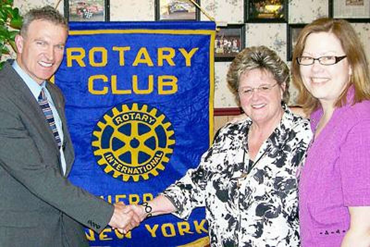 Photo Courtesy SHERRILL ROTARY CLUB Sherrill Rotary Club President Sandra Corney, left, and Donna Schonewetter, program chair, welcome Student of the Month guest speaker Andy Brown, VVS High School principal.