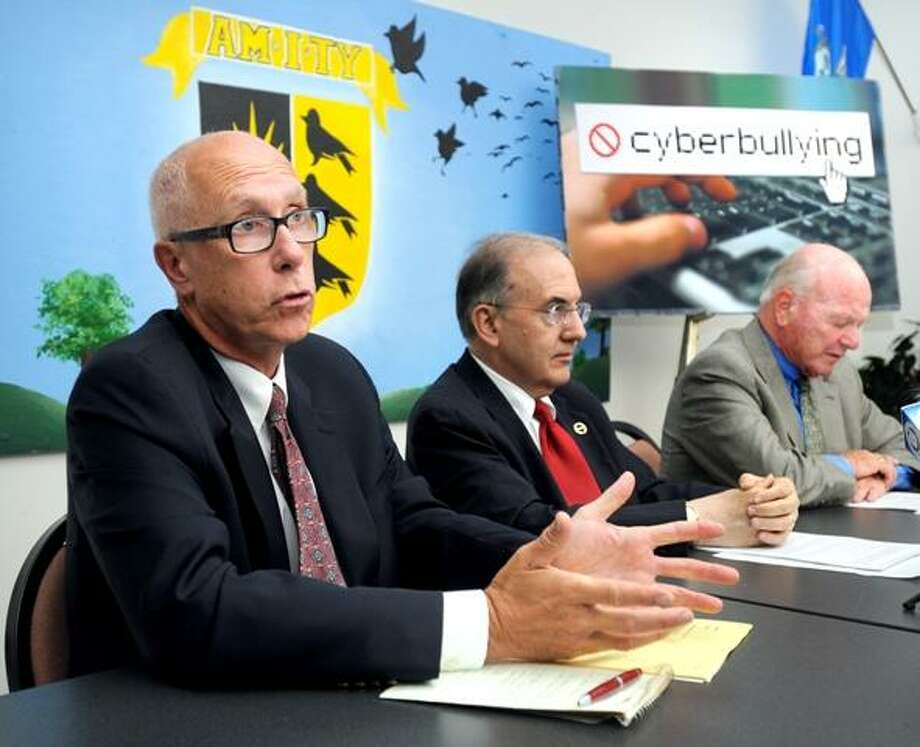 Left to right, Superintendent of Amity Regional School District John Brady, State Senate Majority Leader Martin Looney and State Senator Joseph Crisco, Jr. speak about a new state law concerning cyberbullying in Woodbridge on 9/7/2011. Photo by Arnold Gold/New Haven Register