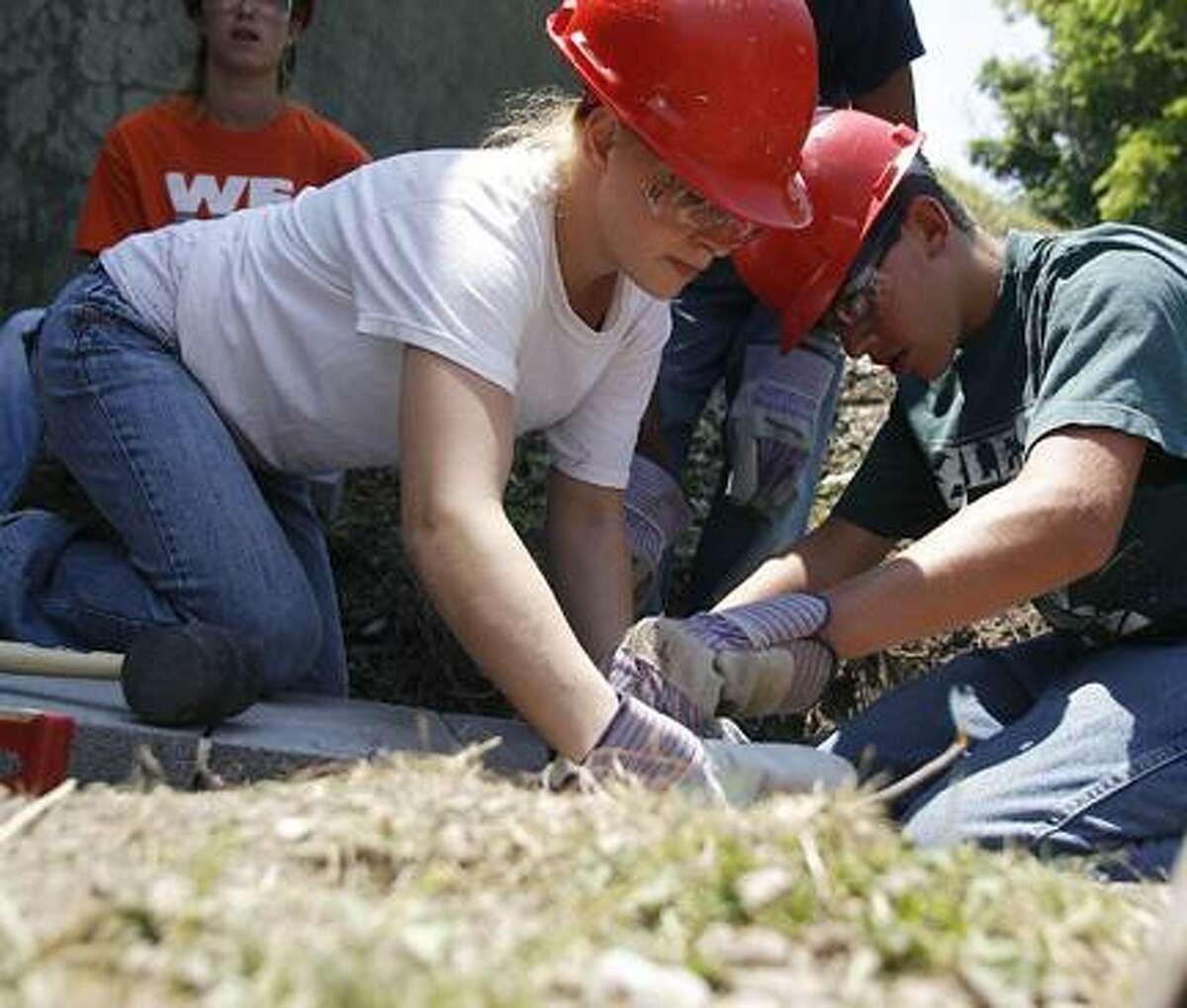 Photo by JOHN HAEGER (Twitter.com/OneidaPhoto) Summer Youth Employment Program for Madison County workers Sarah Magee and Tyler Jeffris set the first block for one of two 50-foot retaining walls that will be built at the railroad bridge on Main Street in the village of Canastota on Tuesday, July 5, 2011.