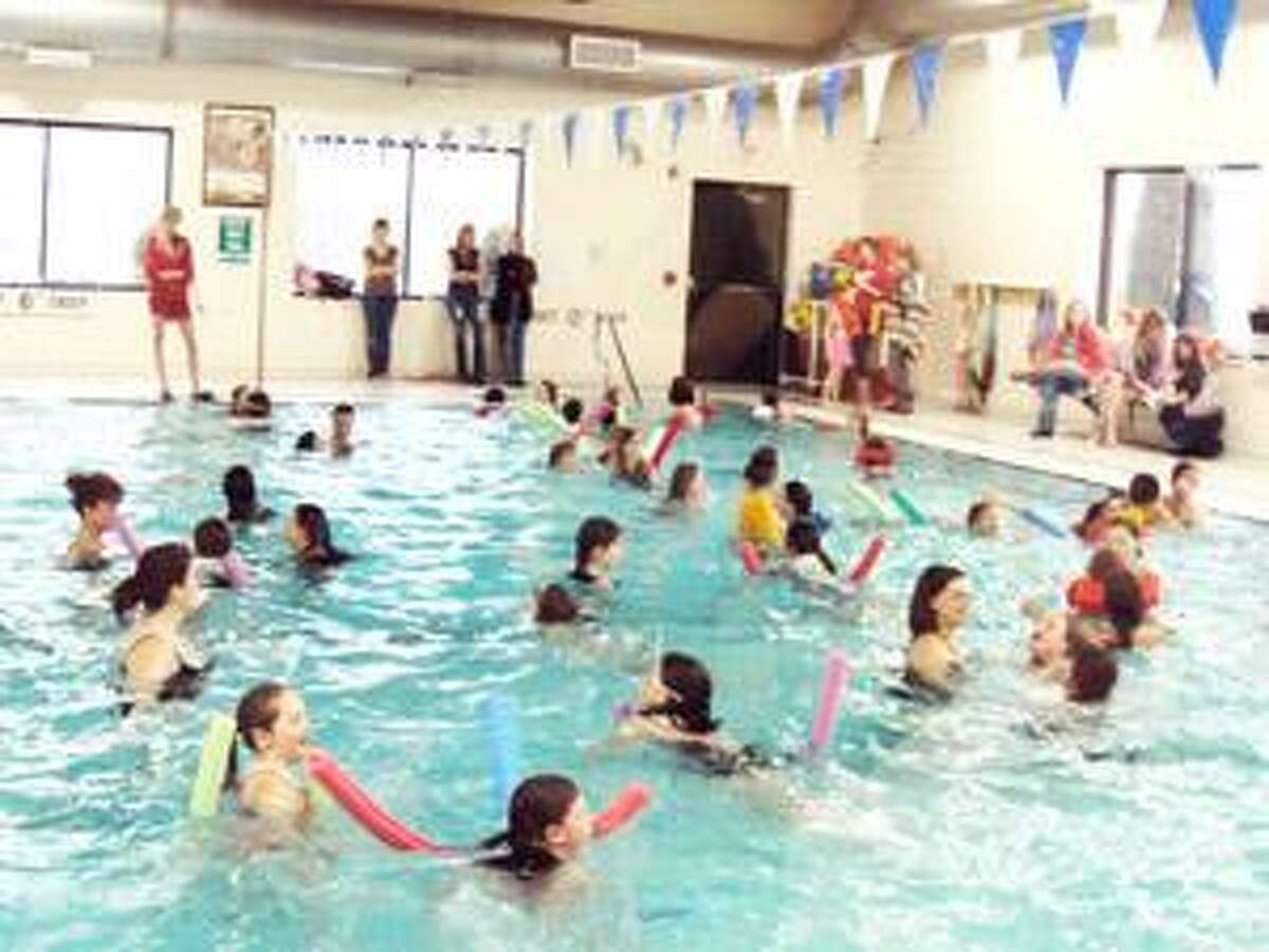 SUBMITTED PHOTO Fifty-four Girl Scouts from troops in the Oneida, Durhamville and Stockbridge area recently enjoyed a pool party at the Oneida Family YMCA. The event was sponsored by Unit 230 of the Girl Scouts of NYPENN Pathways Council.