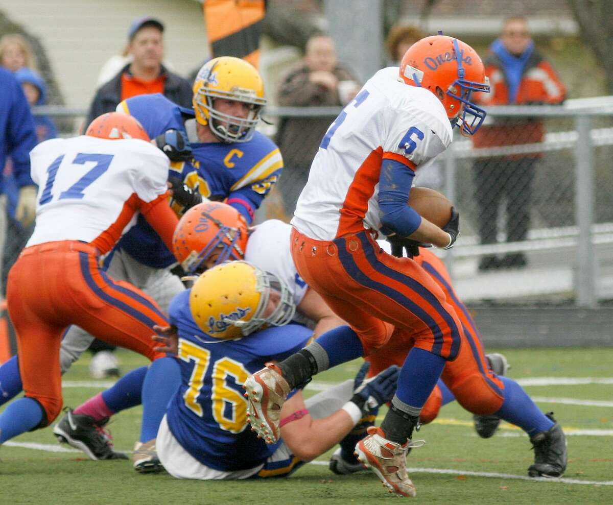 Dispatch Staff Photo by JOHN HAEGER (twitter.com/oneidaphoto) Oneida's Brandon Worley (6) looks for room to run as Cazenovia players move in to defend in the Section III Class B semifinal October 29, 2011 at Chittenango. Oneida will play Chittenango in the final at 5 p.m. Saturday, October 5, 2011 at the Carrier Dome.
