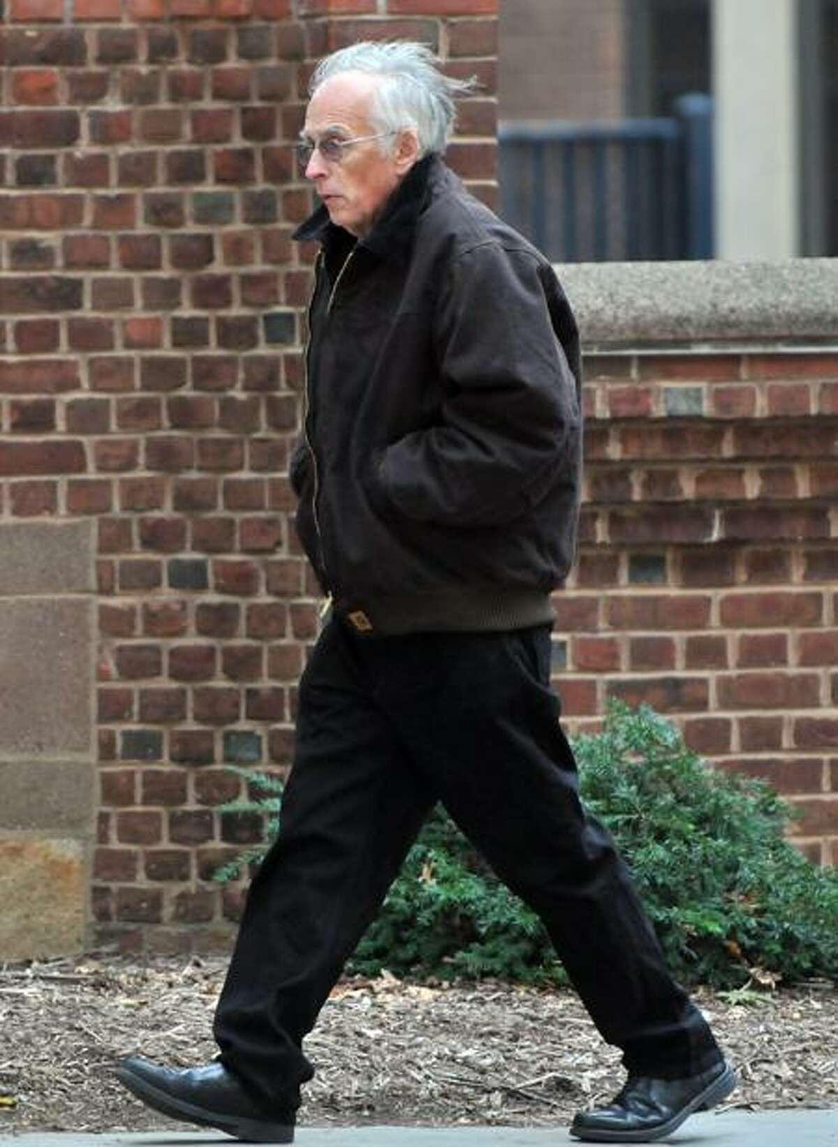 Benedict Komisarjevsky, father of Joshua Komisarjevsky, walks on Church Street across from Superior Court Thursday in New Haven. Peter Hvizdak/Register