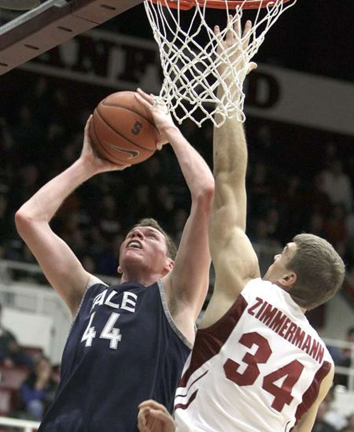 Yale's Greg Mangano (44) goes up for a shot over Stanford's Andrew Zimmerman (34) during the first half of a game last December in Stanford, Calif. (AP file photo/Ben Margot)