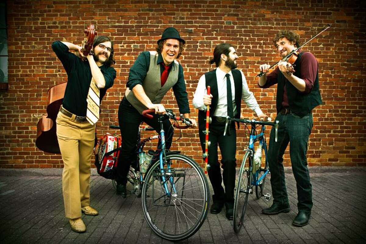 Contributed photo: The Steel Wheels, shown here on one of their bike concert tours, bring their trademark four-part harmonies to Cafe Nine this weekend.