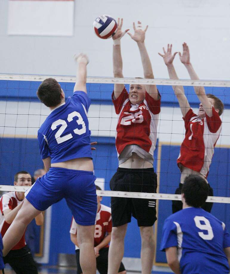 Dispatch Staff Photo by JOHN HAEGER VVS' Jordan Loboda (26) and Steve Geer (1) block the shot of LWA's Sam Cerelli (23) in the second game of the Section III Class B finals in Oneida on Saturday, March 5, 2011. VVS won 3-1.