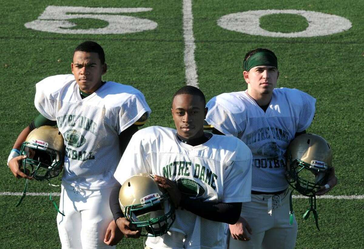 Notre Dame of West Haven football captains left to right: Davante Mallard of Hamden, Amihr Bess of New Haven, Anthony Masucci of East Haven. Photo by Mara Lavitt/New Haven Register 11/1/11