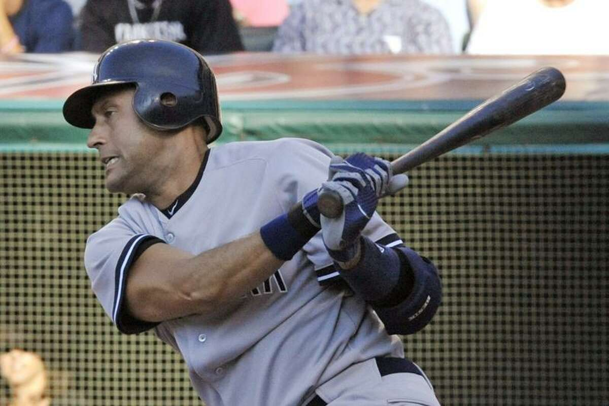 New York Yankees' Derek Jeter follows through on a swing in the first inning of a baseball game against the Cleveland Indians, Monday, July 4, 2011, in Cleveland. Jeter was safe at first base on an error by Cleveland Indians third baseman Lonnie Chisenhall. (AP Photo/Ron Kuntz)