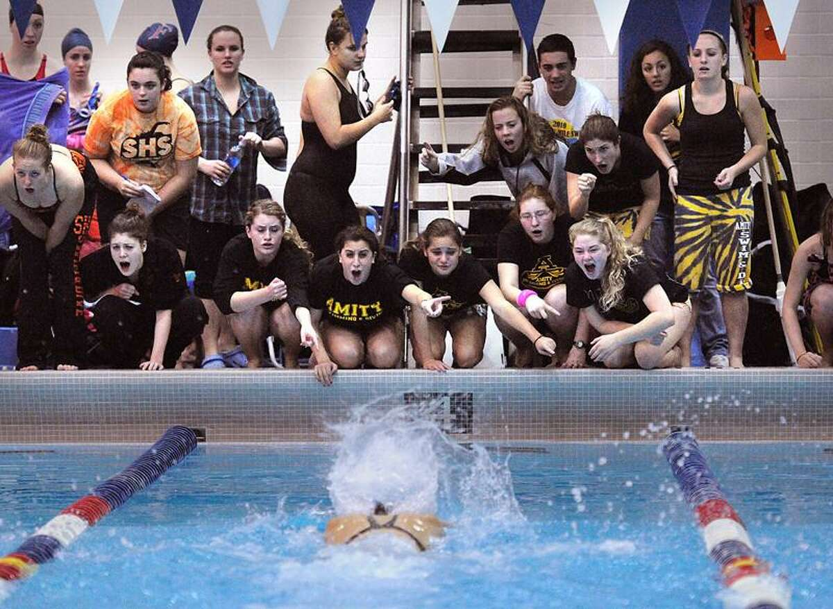 Hamden-- Amity swimmers cheer Dana Grindall on her way to winning the 100-yard butterfly as Amity won the CIAC LL State Open Swim Meet at SCSU. Peter Casolino/New Haven Register11/02/11