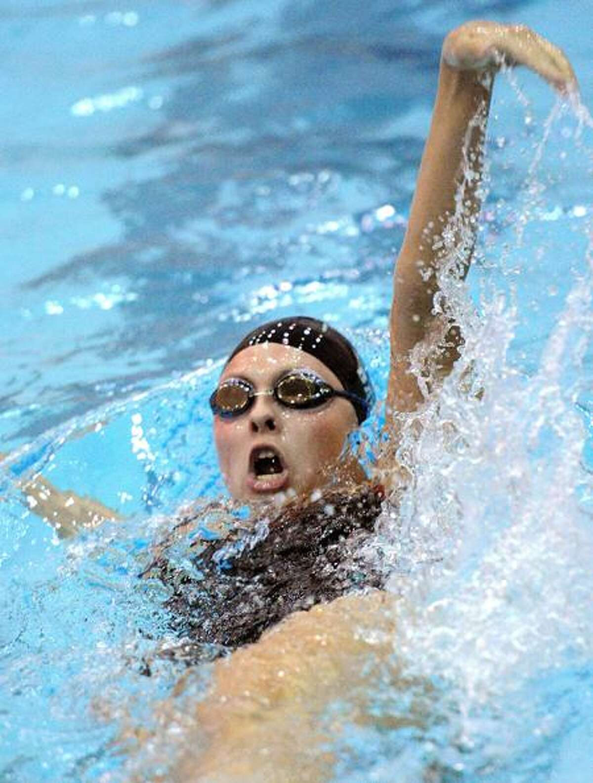 Hamden-- Cheshire's Sara Barlock on her way to a 2nd place in the 100-yard backsytroke. Cheshire came in 2nd as Amity won the CIAC LL State Open Swim Meet at SCSU. Peter Casolino/New Haven Register11/02/11