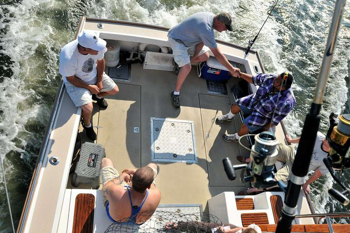 Clockwise from top left, Veteran Angler Charters crewmen Mike Pollio and Scott McNulty, Gulf War Army veteran Melvin Morales, Marine Corps veteran Ray Dishen and Iraq War veteran Brian Youssef. (Brad Horrigan/Register)