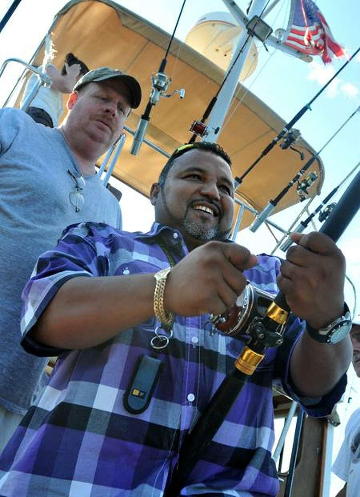 Gulf War Army veteran Melvin Morales reels one in. (Brad Horrigan/Register)