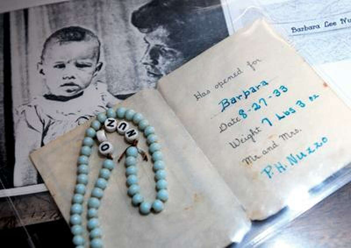 Barbara's baby bracelet is part of the collection, which includes letters, photographs, certificates, cards and other assorted items.