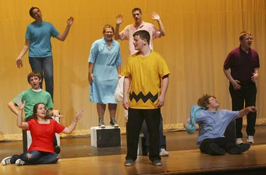"Dispatch Staff Photo by JOHN HAEGER (Twitter.com/OneidaPhoto)Ryan Geer, center in yellow, who plays Charlie Brown rehearses a scene from the VVS Drama Club production of ""Your a Good Man Charlie Brown"" on Wednesday Nov. 2, 2011 along with fellow cast members."