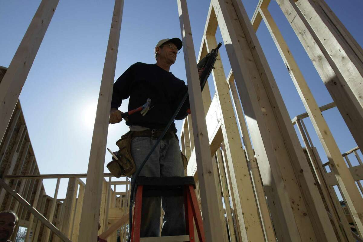 Janez Bratrovic frames a new home Tuesday in Pepper Pike, Ohio. U.S. builders spent slightly more in September on home construction, partially offsetting losses in public schools, roads and government offices. (AP Photo/Tony Dejak)