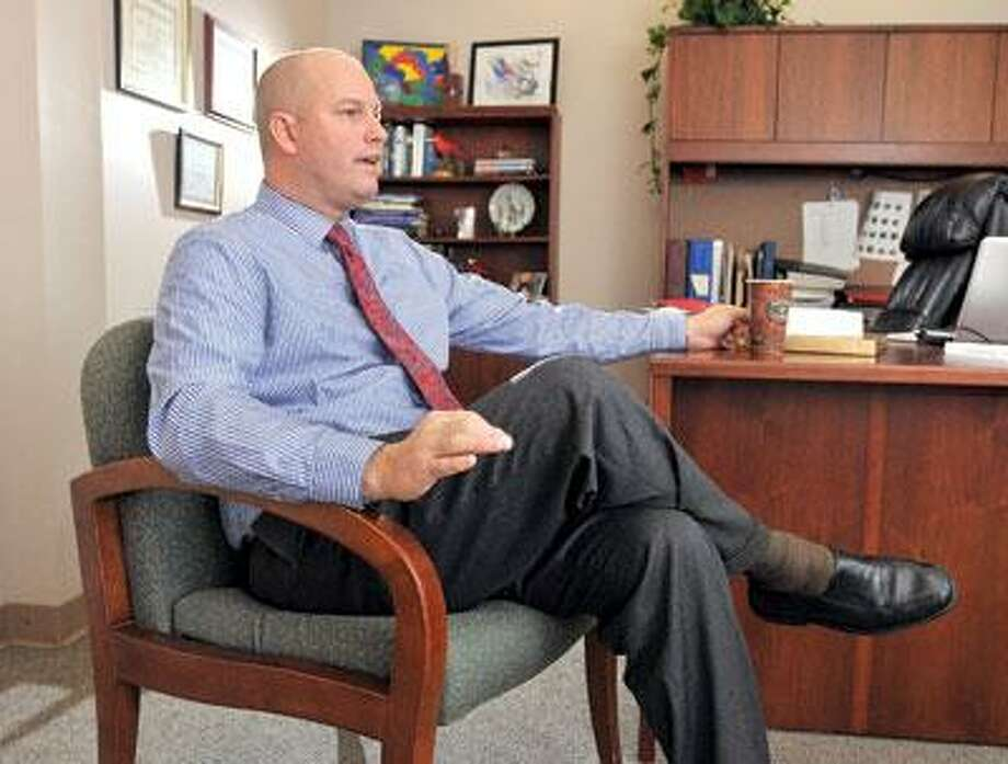 Michael Storz, who was recently named president of Chapel Haven, talks about some of the agency's accomplishments. (Peter Casolino/Register)