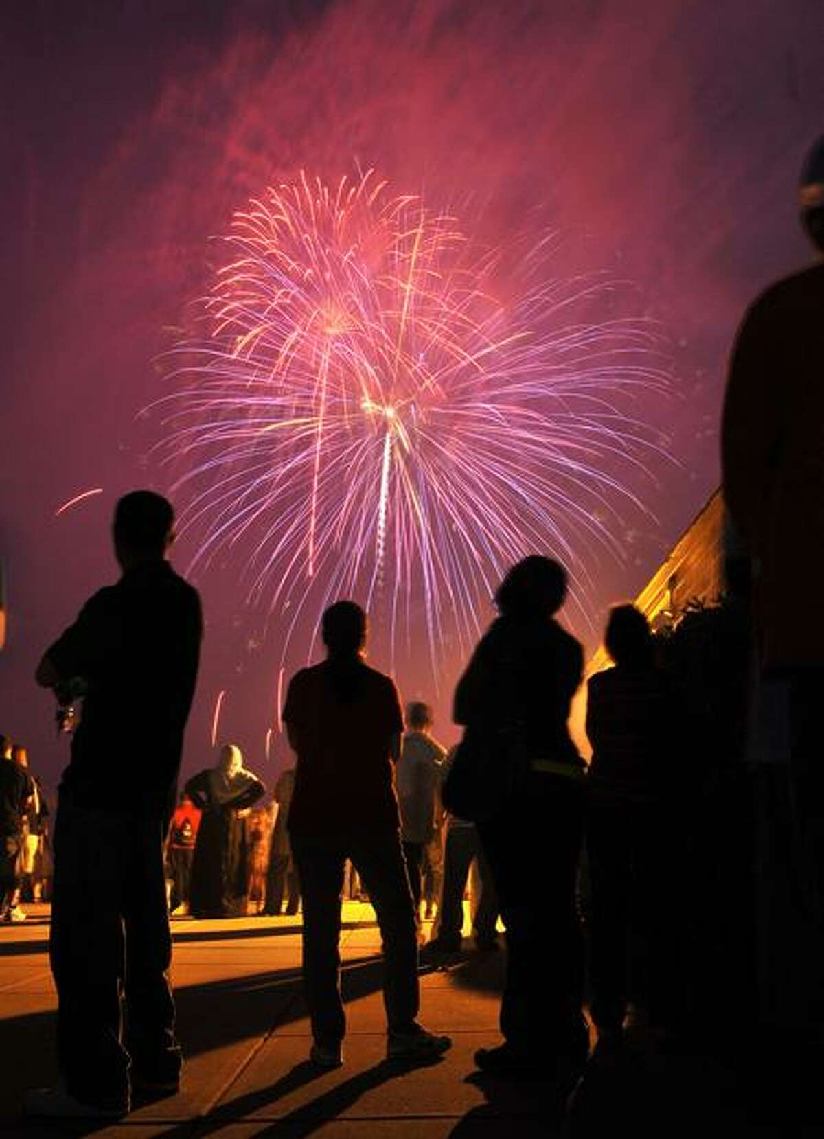 Thousands gathered to watch the West Haven fireworks along the boardwalk near Savin Rock in West Haven on Sunday night. (Peter Casolino/Register)