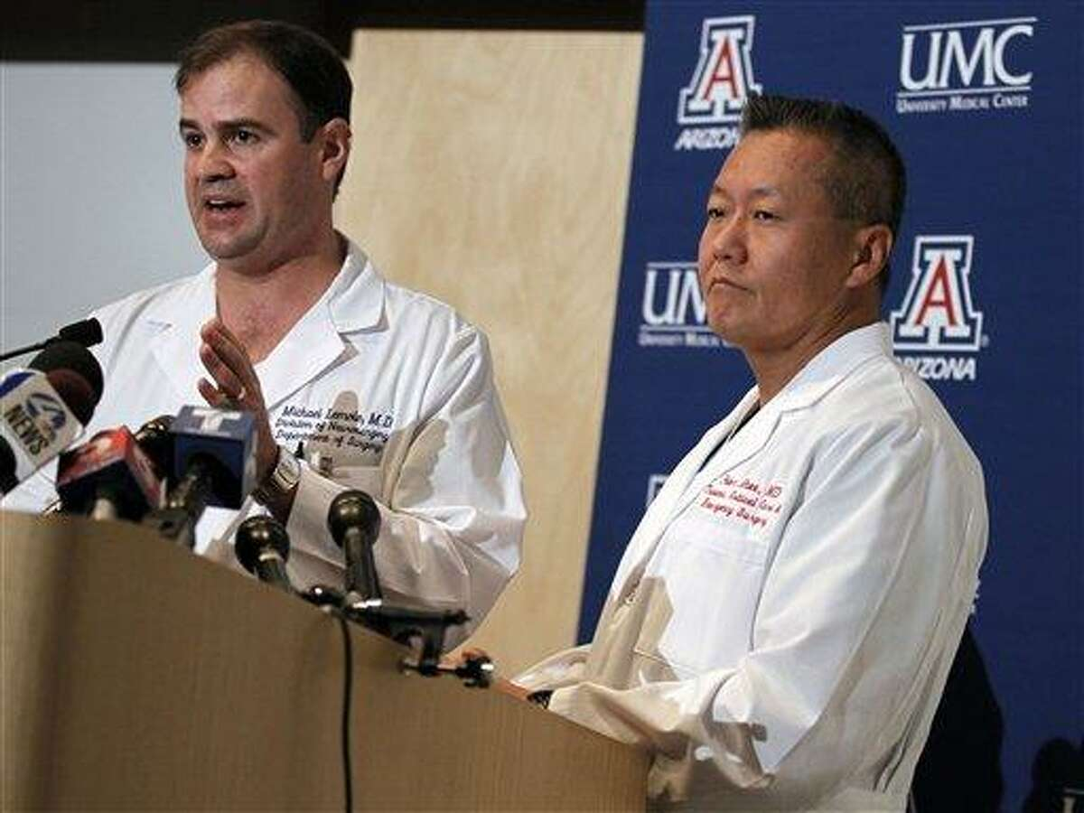 Dr. G. Michael Lemole, Jr., left, speaks about the condition of U.S. Rep. Gabrielle Giffords, D-Ariz., as Dr. Peter Rhee looks on at University Medical Center during a news conference in Tucson, Ariz., Sunday, Jan. 9, 2011. Giffords was shot in the head the Saturday during a speech at a local supermarket. (AP Photo/Chris Carlson)