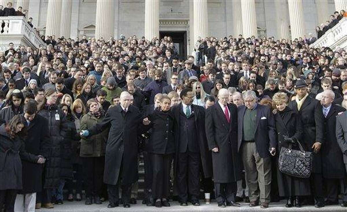 Members of Congress and staff members observe a moment of silence for Rep. Gabrielle Giffords, D-Ariz., and other shooting victims, Monday, Jan. 10, 2011, on the East Steps of the Capitol on Capitol Hill in Washington. Giffords was shot Saturday in a Tucson shooting rampage that left six people dead. Pictured from ninth left to right: Wilson Livingood, Sergeant at Arms, U.S. House of Representatives; Del. Eleanor Holmes Norton, D-D.C.; Rep. Emanuel Cleaver, D-Mo.; Steve Lawrence, chief of staff to House Minority Leader Nancy Pelosi of Calif.; Barry Jackson chief of staff to House Speaker John Boehner of Ohio; Del. Madeleine Bordallo, D-Guam; Rep. Hank Johnson, D-Ga.; and Senate Sergeant at Arms Terry Gainer. (AP Photo/Charles Dharapak)