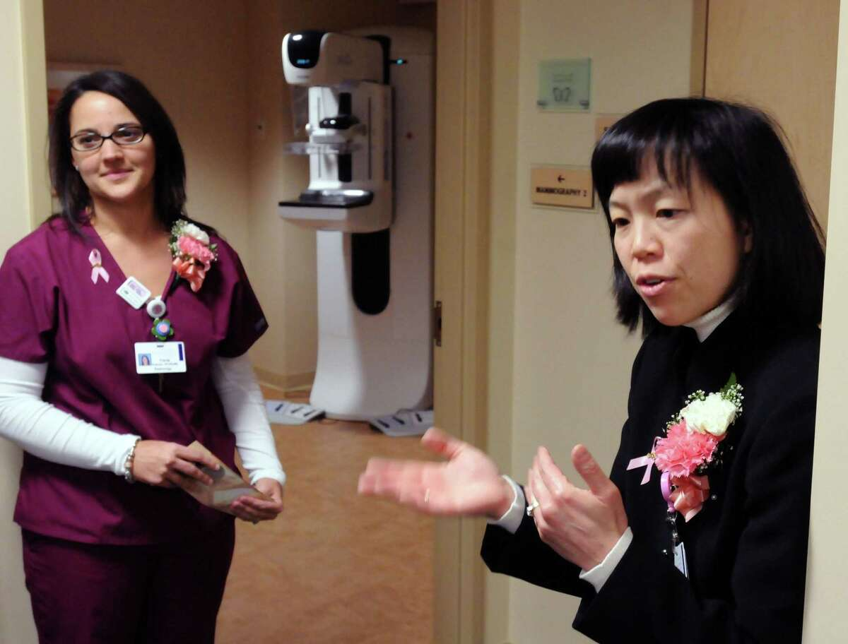 Griffin Hospital in Derby officially opened its Center for Breast Wellness. The Center's medical director Dr. Zandra Cheng right near a mammography room with mammographer Tricia Palmer of West Haven left. Photo by Mara Lavitt/New Haven Register1/10/11
